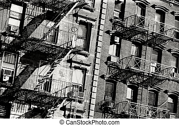 Fire escape - Black and white photo of the exterior of a...