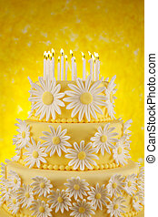 Daisy birthday cake - Three tier fondant cake with candles...