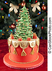 Christmas fondant cake against christmas tree background