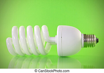 Energy efficient light bulb on green background