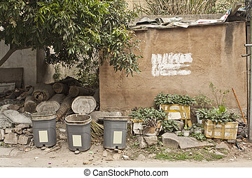 Chinese village with houses and rubbish bins