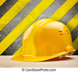 Under construction - industrial concept with yellow hardhat,...