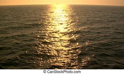 Golden Ocean - This is a shot of golden pacific ocean at...