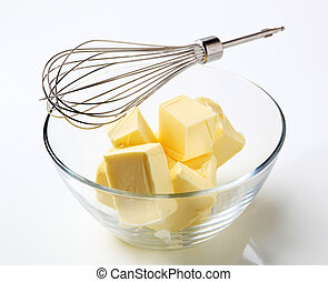 Fresh butter - Blocks of fresh butter in a bowl and metal...