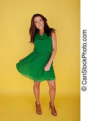 Woman In Green Dress Twirling Her Skirt, full length...