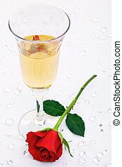 Red rose and a glass of champagne