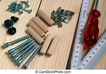 Carpenting - Tools for carpeting a new furniture.