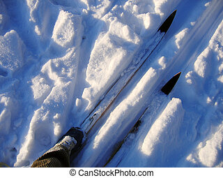 Cross country skis - feet and skis on the track in the white...