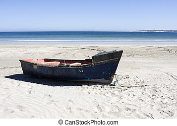 Boat on a secluded beach in Paternoster, South Africa