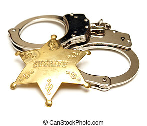 Sheriff Badge and Handcuffs - An isolated shot of a sheriff...