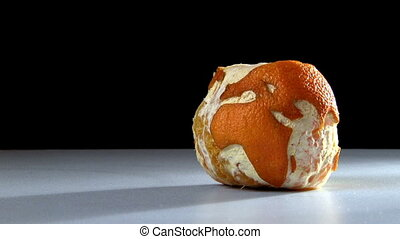 Planet earth made of orange, cut with blade, rotten
