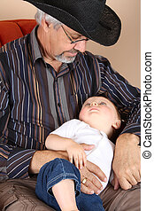 Grandfather and Grandson - Baby boy lying on his...