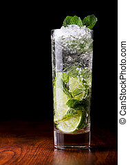 Mojito Cocktail on a wooden table and black