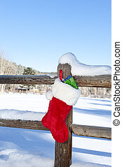 Christmas Stocking on Fence - A Christmas stocking stuffed...