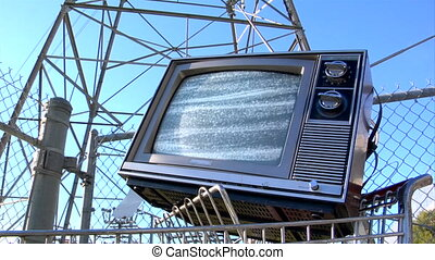 TV power tower static - This is a retro TV sitting in a...