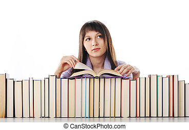 young woman behind a big pile of books