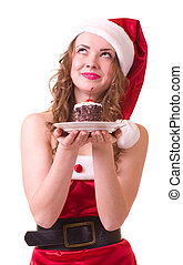 Beautiful young girl in Santa Claus clothes with tasty cake...