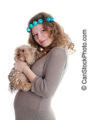 The pregnant woman with a puppy