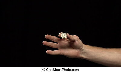 magic trick on black - A mans hand performs a magic trick on...