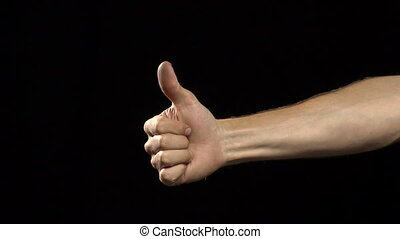 thumbs - a variety of thumbs up and thumbs down by a man's...