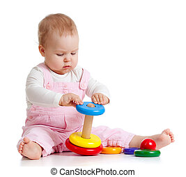 baby playing with color toy