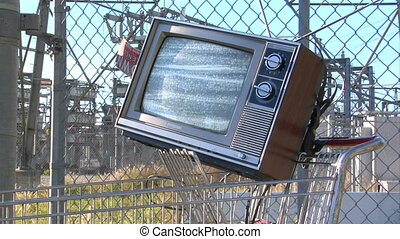 TV power station static - This is a retro TV sitting in a...
