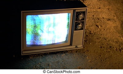 TV reststop cu - This is a unique shot of a retro TV sitting...