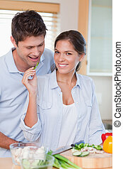 Portrait of a beautiful couple cooking