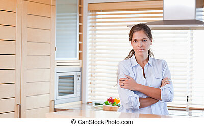Woman standing up in a kitchen