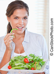 Portrait of a woman eating a salad