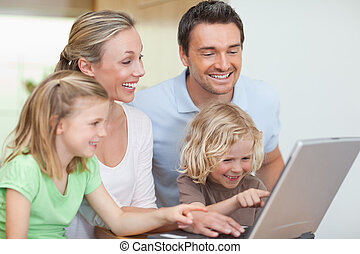 Family surfing the web together