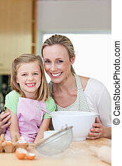 Mother and daughter having good time in the kitchen