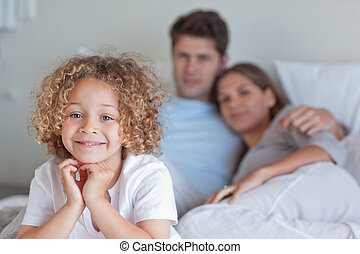 Boy sitting on his parents's bed