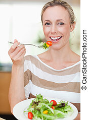 Woman eating some salad