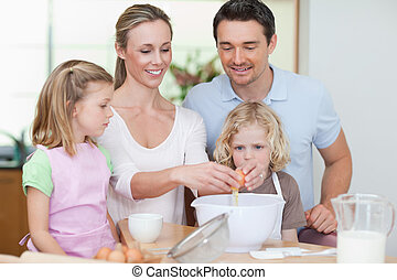 Family preparing dough together