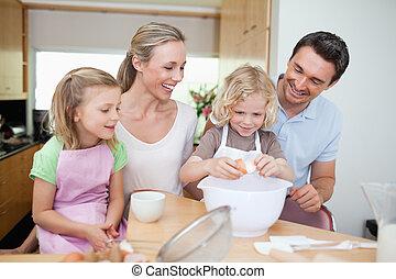 Family preparing cookies