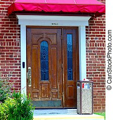 DOOR WITH CANOPY - A weathered door surrounded by bricks and...