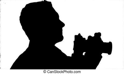 Photographer Silhouette close-up -