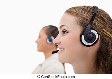 Side view of operators using headsets