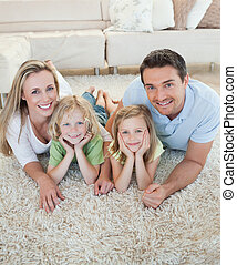 Happy family on the floor - Happy family together on the...