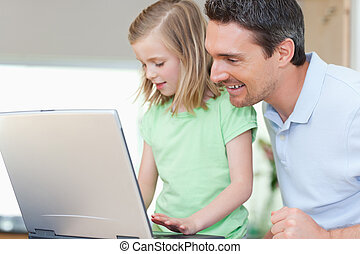 Father and daughter with notebook - Father and daughter...