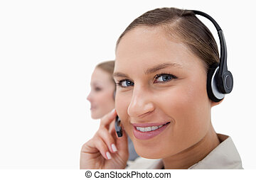Young sales persons using headsets