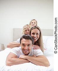 Family lying on each other