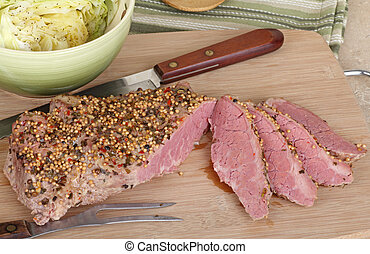 Sliced Corned Beef - Sliced corned beef with cabbage on a...