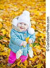 Little Girl With Yellow Leaf