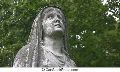 Madonna Two shots - Statue of a Madonna in a cemetery...