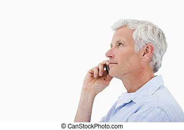 Side view of a man making a phone call