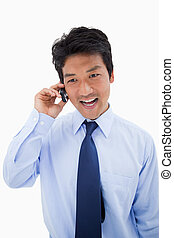 Portrait of a surprised businessman making a phone call