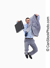 Happy businessman jumping against a white background