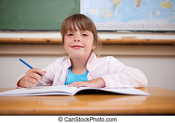 Cute girl writing